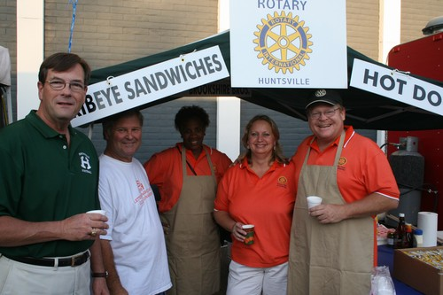 Rotarians set up for Fair on the Square