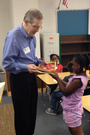 Past District Governor Rotarian Dan Davis in 2013 helping distribute I Like Me! Books